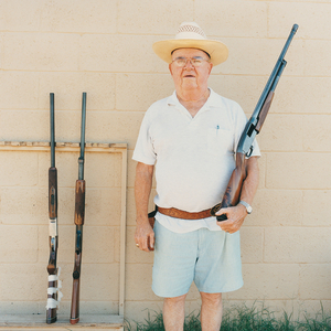 Man with guns, from the series Sun City © Peter Granser