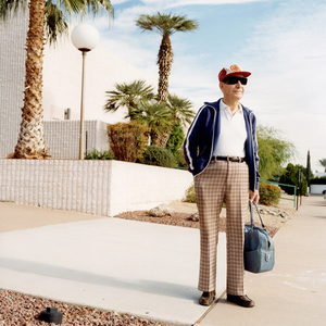Man with a bag, from the series Sun City © Peter Granser