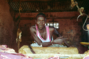 Although he lives in an outlying suburb of Dakar, and enjoys a much more traditional life than his counterparts who live or work in central Dakar, this butcher's old school style looks like it might have been lifted directly from an early 1980s music video. © Sharon Stark