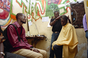 Nana is the hot haircutter in Dakar, and the style-conscious line up for hours for one of his cuts. © Sharon Stark