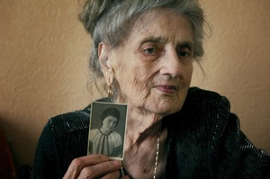 "Anna Vasilievna Bigus, 88, spent ten years of her youth in the Gulag. At age 19, she was separated from her family and sent into the Arctic Circle. ""The only joy we could have in Gulag was singing. We sang a lot. And this gave us the strength to survive…"" Her daughter became a music teacher and her grandchildren sing in opera. © Elena Chernyshova"