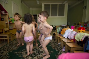 During the summer, the children in the kindergarten do physical exercises without clothes. This teaches them to adapt better to the cold. © Elena Chernyshova