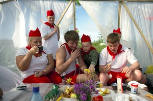 "Each year, the inhabitants of Norilsk celebrate the arrival of summer with joy. A three-day meeting is organized in the tundra, during which various competitions are held: canoeing, climbing and so on. Each team has its own motto, anthem and outfit. Here is a team called ""Pioneer of our Era"", eating breakfast before a day of competition. © Elena Chernyshova"