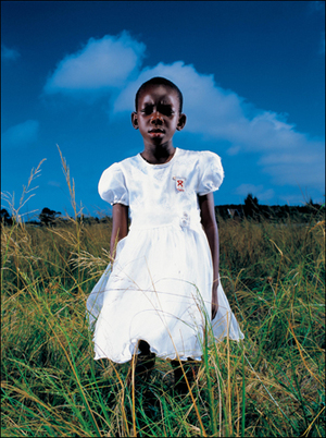 3rd prize Portraits Singles<BR>© Brent Stirton, South Africa, Getty Images for Global Business Coalition against Aids.<BR>Aids orphan, South Africa<BR><BR>A young Aids orphan stands in a field near Richards Bay, on the South African east coast. Both her parents are dead, and she is being cared for by members of her community.