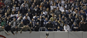 1st prize Sports Features Singles. © Robert Gauthier, USA, Los Angeles Times Magazine. Yankee fans try to distract Angels left fielder Juan Rivera, Yankee Stadium, 25 October