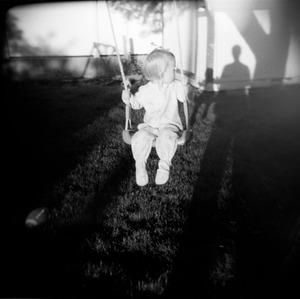 "Amelia (Swing). Layton, Utah. From the series ""Childhood Reveries""  © Brian Shumway"