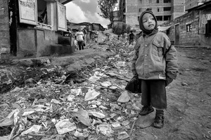 © Tony Corocher - Something ahead… maybe.I ran into this little boy the first day in Mathare Slum (Nairobi). He was going to school. Behind him one of the streets that leads into the slum.