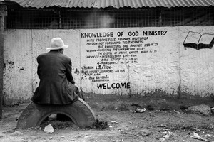 "© Tony Corocher - Disillusion...Come to church and ""the knowledge of God Ministry"" will save you from desperation! Welcome to Mathare!!!When I saw this man I immediately pictured him as someone who had seen it all, someone who knew that with or without religion there is no easy way out… Complete, total poverty pushes men to believe, just in order to have a little hope. Right or wrong, it is still"