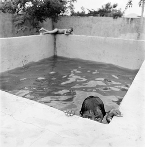 "Pool Boys. La Chureca, Managua, Nicaragua. From the series ""Childhood Reveries""  © Brian Shumway"