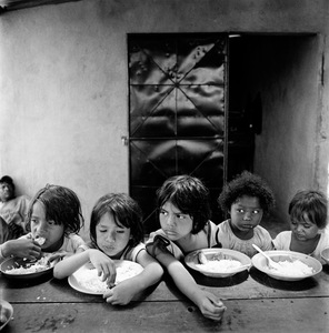 "Girls (Lunch). La Chureca, Managua, Nicaragua. From the series ""Childhood Reveries""  © Brian Shumway"