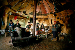 © Evgenia Arbugaeva, Children having lunch in Even teepee. Bulunskiy ulus. August 08