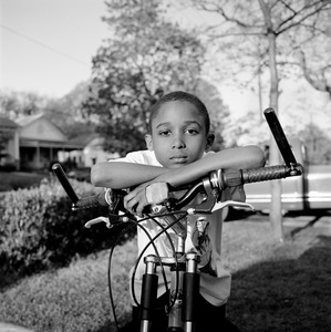 "Boy (Bicycle Handlebars). Atlanta, GA. From the series ""Childhood Reveries""  © Brian Shumway"