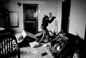 World Press Photo of the Year 2008. © Anthony Suau, USA, for Time. US Economy in Crisis: Following eviction, Detective Robert Kole must ensure residents have moved out of their home, Cleveland, Ohio, 26 March