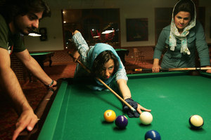 Upper-class youth visit Kish Island for leisure and fun. In Tehran, Islamic law prohibits women to play billiards. IRAN - April 2006 © Copyright 1979-2009 Alfred Yaghobzadeh. All rights reserved.