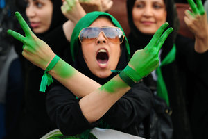 Supporters of former premier Mir Hossein Mousavi attend an electoral campaign rally in Tehran. Tehran, IRAN - June 2009 © Copyright 1979-2009 Alfred Yaghobzadeh. All rights reserved.