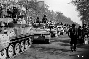 """The Shahs army tank units parading down Shahreza Avenue. Following the success of the revolution, this road was renamed """"Enghelab"""" (Revolution) Avenue. Faced with mounting threats, the Shah declared martial law in September 1978 and imprisoned many suspected opposition leaders and protesters. Tehran, IRAN - February 1, 1979 © Copyright 1979-2009 Alfred Yaghobzadeh. All rights reserved."""