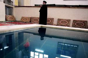 Iranian Shiite Mullah during noon prayer at Grand Ayatollah Borujerdis home. Qom, IRAN - December 2008 © Copyright 1979-2009 Alfred Yaghobzadeh. All rights reserved.
