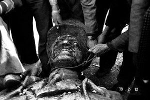 Statue of Shah Mohammad Reza Pahlavi is torn down by demonstrators near Khomeinis temporary headquarters in Tehran, IRAN - February 1979 © Copyright 1979-2009 Alfred Yaghobzadeh. All rights reserved.