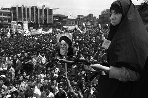 Iranian woman on guard at Khordad - a demonstration against the exile of the leader of the revolution, Ayatollah Khomeini, in one of the main squares in Tehran at the beginning of the Iranian Revolution. Tehran, IRAN  1979 © Copyright 1979-2009 Alfred Yaghobzadeh. All rights reserved.