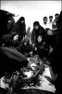 In Abadan cemetery, weeping mothers mourn the loss of their sons during the Iraqi bombardment  1981 © Copyright 1979-2009 Alfred Yaghobzadeh. All rights reserved.