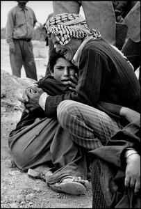 In Ahwaz cemetery, an uncle holds his nephew who lost his parents during the Iraqi bombardment  1981 © Copyright 1979-2009 Alfred Yaghobzadeh. All rights reserved.