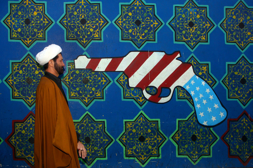 "Thousands of young Iranians proclaimed ""Death to America"" on Sunday as they celebrated the 28th anniversary of the storming of the US embassy in Tehran by student radicals. A massive crowd, composed mainly of school children bussed in to central Tehran, gathered outside the site of the former US embassy. Tehran, IRAN - November 2007 © Copyright 1979-2009 Alfred Yaghobzadeh. All rights reserved."