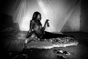 Beside the violence and corruption, drug trafficking also brought marginalization among locals. Crack addiction, a consequence of the drug trade, increased prostitution and caused an unseen wave of HIV and AIDS in the capital, Bissau.  © Marco Vernaschi, 2009