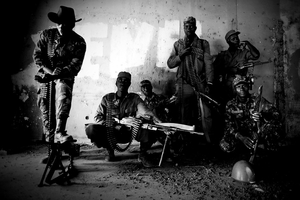 The team of soldiers who executed the President, photographed seven hours after they accomplished their task, in the Military Headquarters in Bissau.  © Marco Vernaschi, 2009