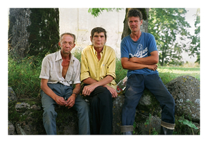 Farmer Kestas Veiksa (left) taking a minute of rest from hay work with workers Vytautas and Romas, July 2002 © Mindaugus Kavaliauskas