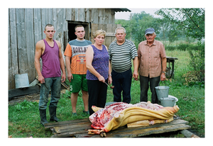 "Marius Trakselis with mother Virga, father Antanas and mother's step-father Aleksandras preparing ""some cutlets"" for student brother Andrius (second from left) leaving for his studies in Kaunas, August 2002 © Mindaugus Kavaliauskas"