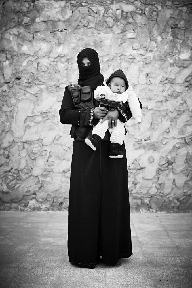 "Fadwa, 20, widow with 3 children: ""My husband died on the front lines, I will die on the front lines, may God help us."" From the series ""Women of War"" © Sebastiano Tomada"
