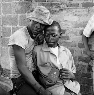 Young men with dompas (identity documents that every African had to carry), White City, Jabavu. November 1972 © David Goldblatt