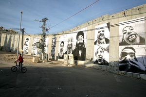 Installation view of JRââ?¬â?¢s work at the separation wall between Israel and Palestine, 2007. © jr