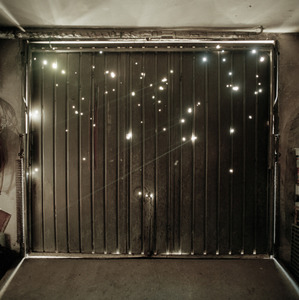 Shell-damaged garage door at a house in Vukovar . © Colin Dutton