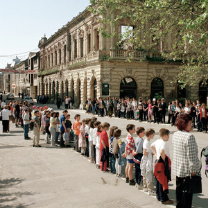People waiting for the arrival of a procession in the town centre. The building behind them hosted the founding of the Yugoslavian Communist Party in 1920.  © Colin Dutton