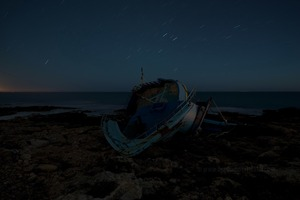 On August 27th, 2013, a boat arrives on the rocks of Fanusa (Siracusa) © Massimo Cristaldi