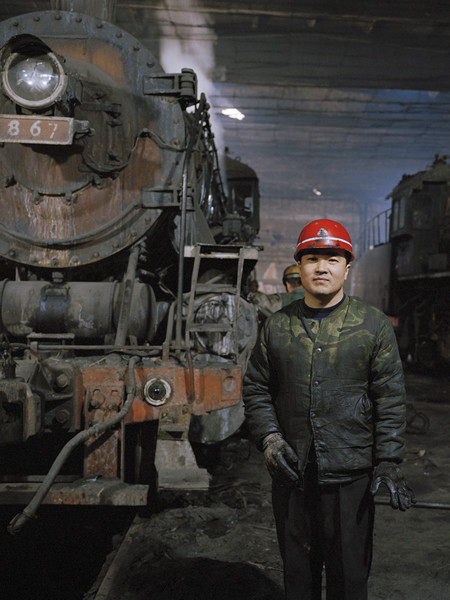 Railway worker at the train repair depot, Lutien Mine © Ollie Woods