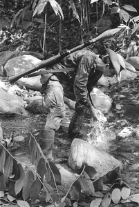 Serrania de San Lucas-Boliviar. A guerlla from the ELN (the National Liberation Army) rests on the shores of the Santo Domingo river. Since 1986 this armed group has caused spills of millions of barrels of oil across Colombian rivers and forests. 1995 © Jesus Abad Colorado, courtesy of Prix Pictet 2008