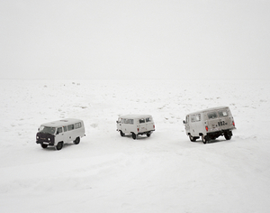 Taxis cross the frozen Lena River. Yakutsk. Far East Russia, November 2004 From the book, Motherland, by Simon Roberts © Simon Roberts