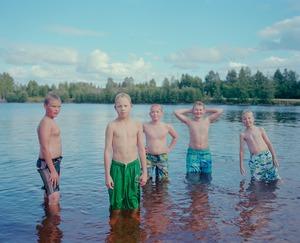 "Boys in water. From the exhibition ""Kainuu"" © Jussi Sarkilahti"