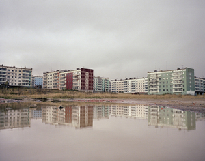 Apartment blocks reflected in water. Sakhalin Island. Far East Russia, October 2004 From the book, Motherland, by Simon Roberts © Simon Roberts