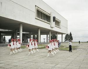 A marching school band pass under Lenin. Ulyanovsk. Volga, June 2005 From the book, Motherland, by Simon Roberts © Simon Roberts
