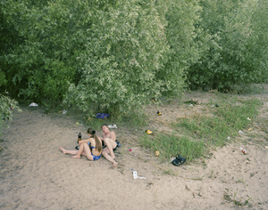 Young lovers on the banks of the Volga River. Astrakhan.Volga, June 2005 From the book, Motherland, by Simon Roberts © Simon Roberts