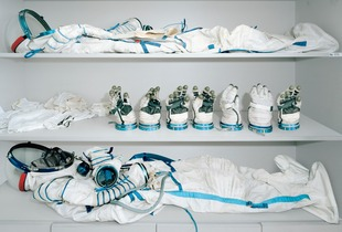 Astronaut dressing room. The Sokol suits were introduced in 1973 and are still in use today. Their purpose is to keep the astronaut alive in the event of an accidental depressurization of the spacecraft. They cannot be used outside the spacecraft. The suit uses an open-circuit life support system that somewhat resembles scuba equipment and weights around 10kg. © Edgar??Martins