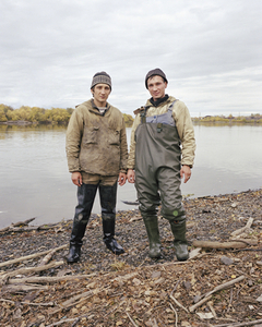 Sturgeon poachers, Kolya Koryakin and Xena Vassif. Kamchatka Peninsula. Far East Russia, October 2004 From the book, Motherland, by Simon Roberts © Simon Roberts