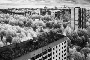 Menace  the horizon - the ill-fated powerstation casts a long shadow over the deserted city of Pripyat © Darren Nisbett