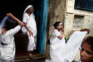 Vrindavan, India, 2009 - Widows leaving the Ashram wearing the traditional white dress. In India, white is the traditional color of mourning. © Massimiliano Clausi/POSSE Photographers