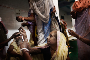 Vrindavan, India, 2009 - The widows are payed six rupies a day (12 cents USD) for singing in the Ashrams. With that money they'll have to buy food and pay for their accommodation. © Massimiliano Clausi/POSSE Photographers