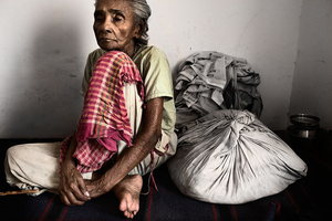Vrindavan, India, 2009 - One of the ladies who used to live on the streets for years, keeps packing her belongings every morning as if she is expecting to be forced to leave at any time. © Massimiliano Clausi/POSSE Photographers