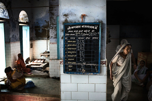 Vrindavan, India, 2009 - The blackboard where daily figures of widows in the Ashram are noted down. © Massimiliano Clausi/POSSE Photographers